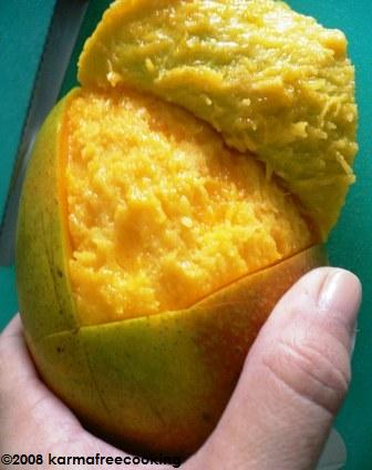 How to peel and eat a mango karmafree cooking when youre done eating that side of the mango just turn it upside down hold the pit in your hand and pull the rest of the peel to expose the remaining ccuart Image collections