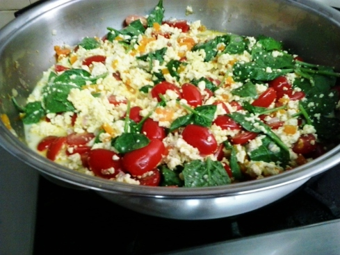 Tofu Scramble with tomatoes, onions, peppers and fresh baby spinach.